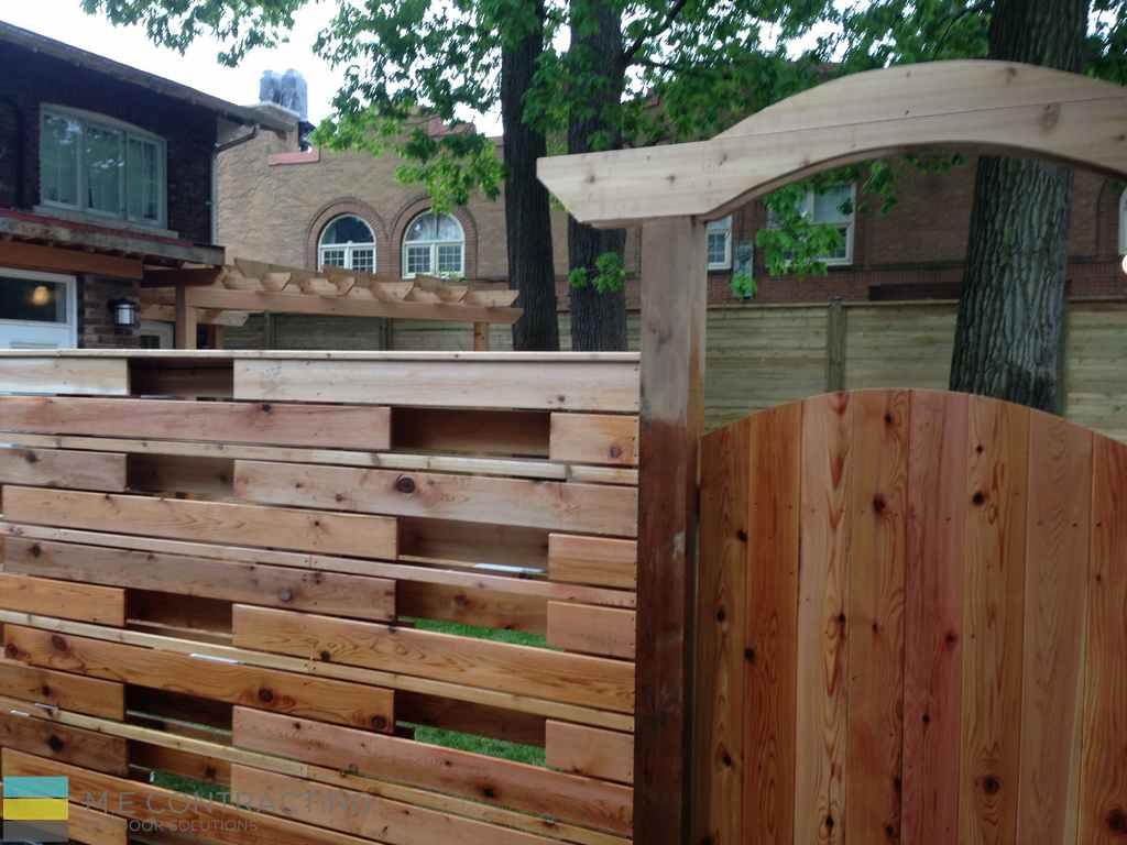 Cedar and pressure treated deck with pergola, landscaping and stone veneer and cedar fence with gate