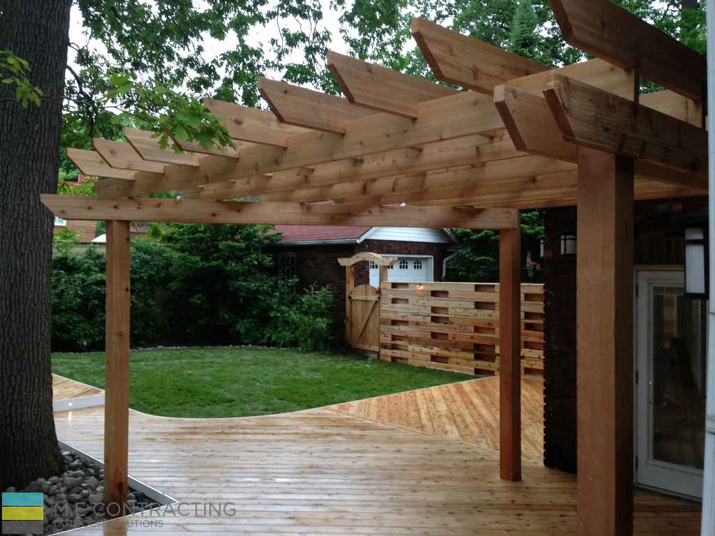 Cedar and pressure treated deck with pergola, landscaping and stone veneer