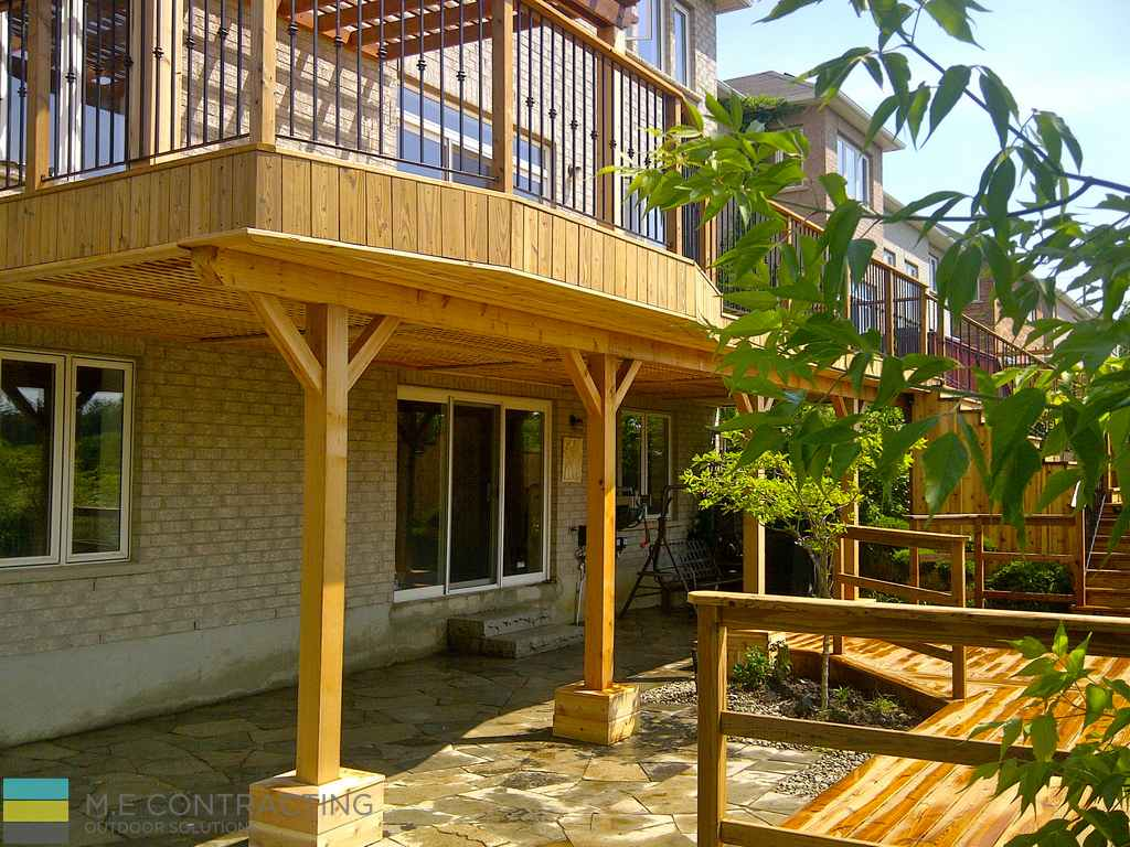 Cedar deck with pergola and interlock basement walkout Walkout basement deck designs