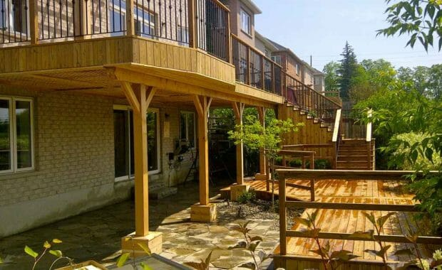 Cedar Deck with pergola and interlock basement walkout