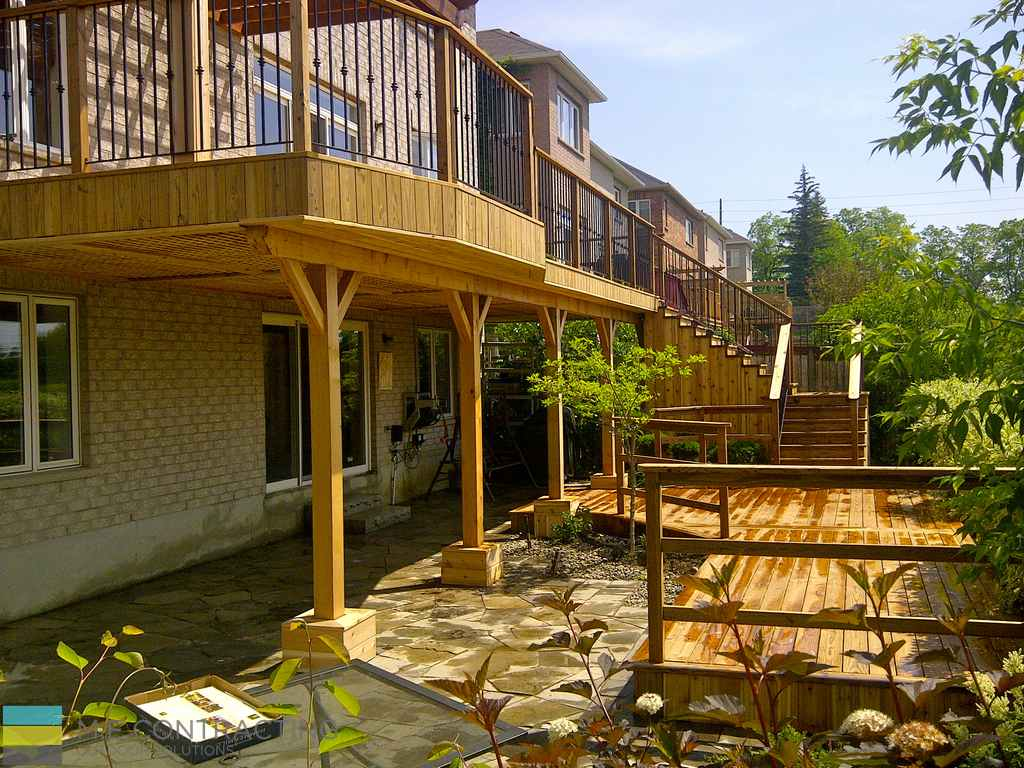 Cedar deck with pergola and interlock basement walkout m Walkout basement deck designs