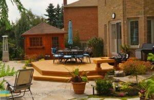 Cedar fence, flagstone interlocking, fiberglass pool with hot tub, landscaping, shed