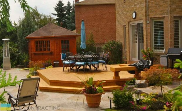 Cedar fence, flagstone interlocking, fiberglass pool with hot tub, landscaping, shed