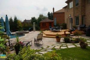 Cedar fence, flagstone interlocking, fiberglass pool hot tub, landscaping, shed