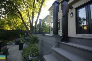PVC deck with skirt, tempered glass railings with aluminum posts and stainless steel clips, interlocking walkway, landscaping, outdoor patio, M.E. Contracting