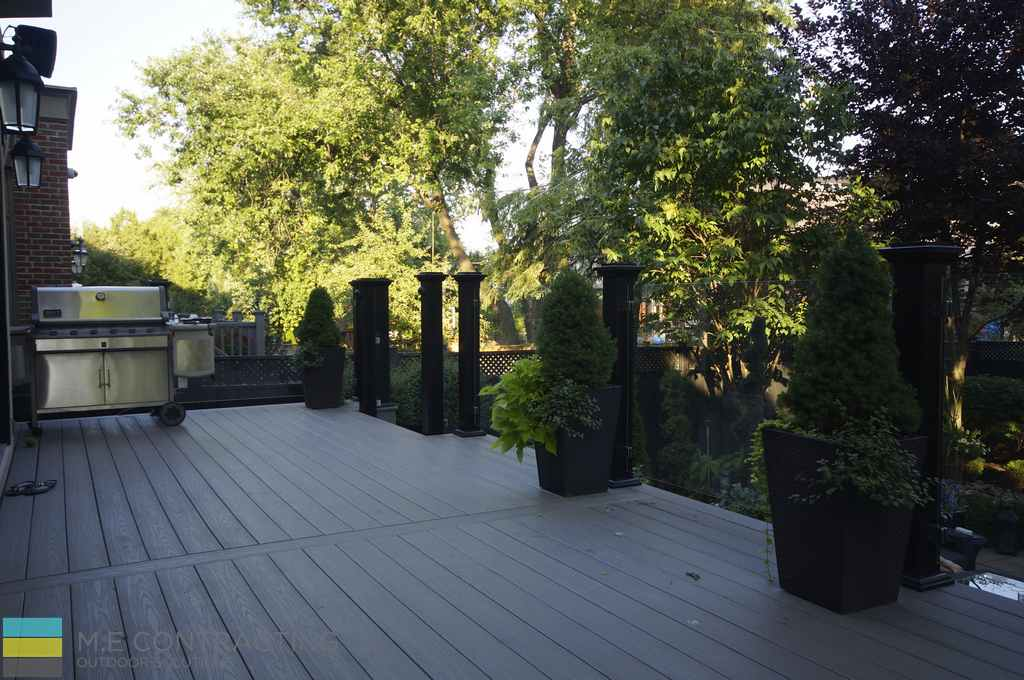 PVC deck with skirt, tempered glass railings with aluminum posts, interlocking walkway, landscaping and cedar fence, outdoor patio, privacy screen, M.E. Contracting
