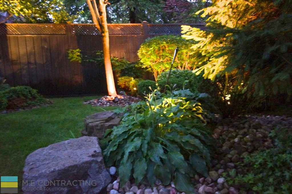 Landscaping, cedar fence, lighting,M.E. Contracting, armor stone, stone pebbles