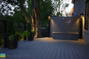 PVC deck with skirt, tempered glass railings with aluminum posts, interlocking walkway, landscaping and cedar fence, lighting, outdoor patio, privacy screen, M.E. Contracting