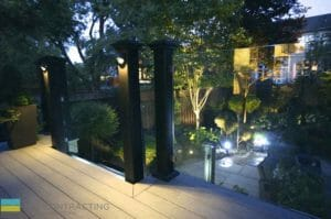 PVC deck, tempered glass railings with aluminum posts, interlocking walkway, landscaping and cedar fence, lighting, outdoor patio, M.E. Contracting