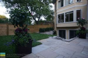 Landscaping, Stone retaining wall, interlocking patio, cedar fence, basement walkout, cedar fence