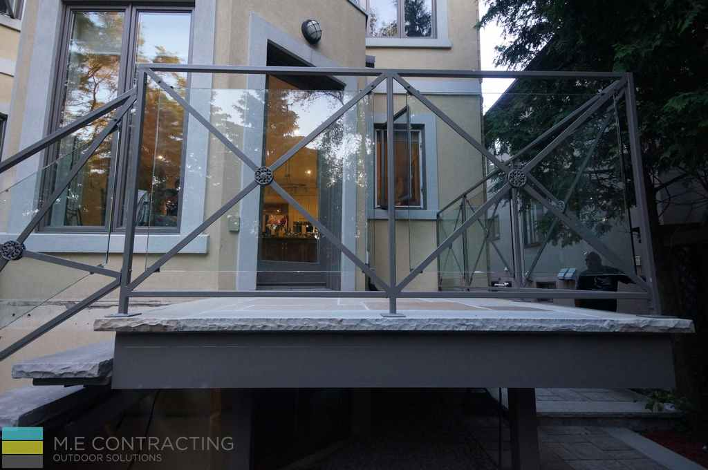 Stone deck, interlocking, tempered glass railings with aluminum frames