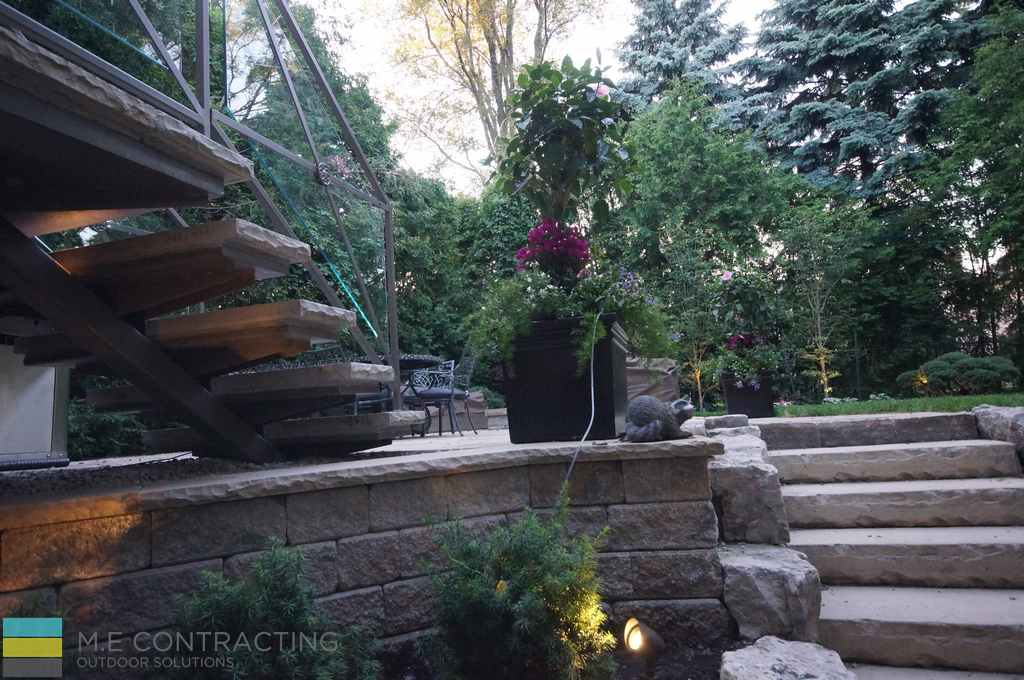Landscaping, walkout basement, fire pit, stone steps, and stainless steel railings
