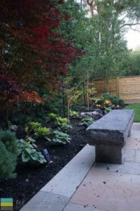 Landscaping, fire pit, interlocking patio, stone bench, cedar fence, lighting