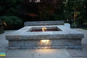 Landscaping, fire pit, interlocking patio, stone bench, lighting