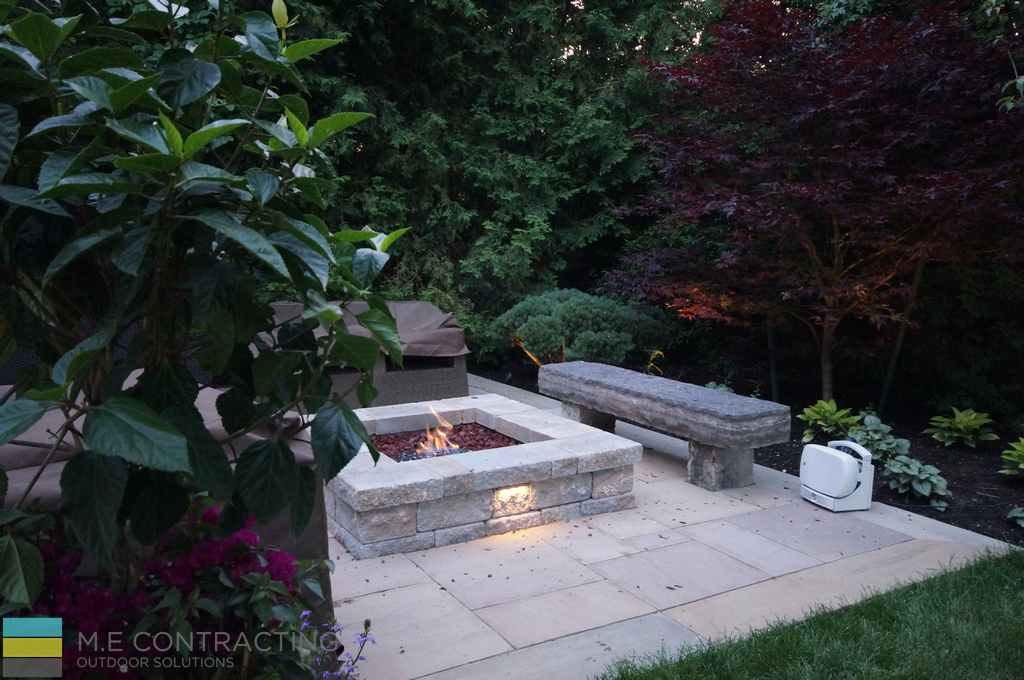 Landscaping, fire pit, interlocking patio, stone bench