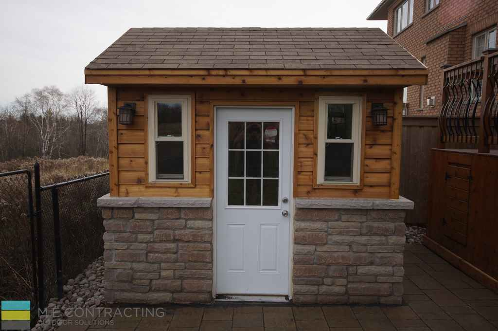 custom cedar deck shed, interlocking, landscaping, and pressure treated deck