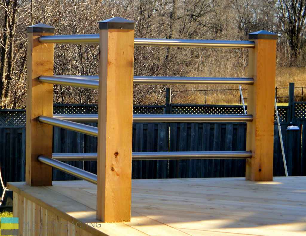 Cedar deck with skirt, light luminated caps, stainless steel fence with cedar posts