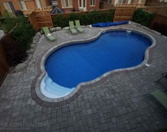 Flagstone pool deck with pergola, driveway and deck