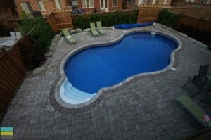 Interlocking patio, fiberglass pool, landscaping, cedar fence and privacy screen