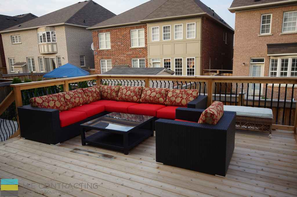 Cedar deck, aluminum railings with cedar posts and frames, outdoor furniture, stone veneer