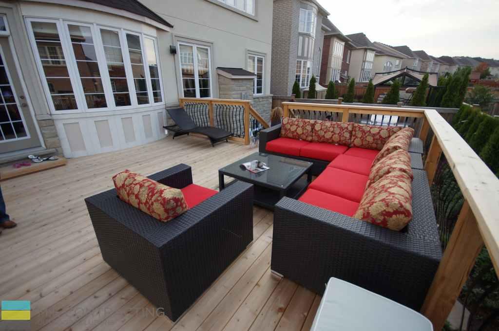 Cedar deck, aluminum railings with cedar posts and frames, outdoor furniture, stone veneer