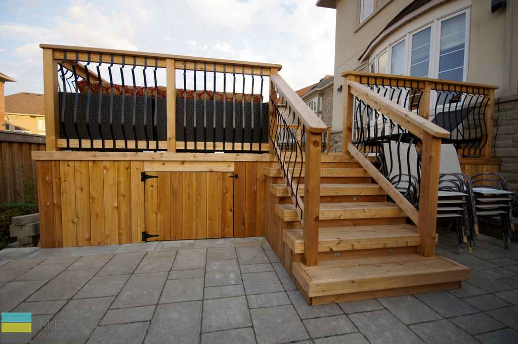 Pressure treated deck, stone veneer, pressure treated frame railings with aluminum, and landscaping