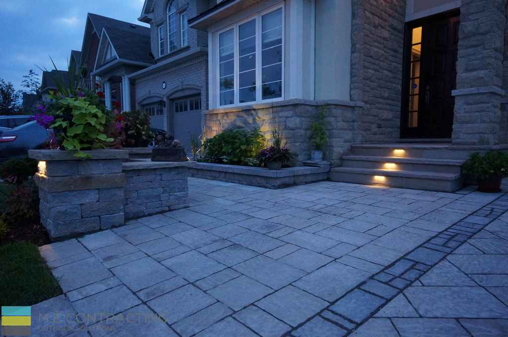 Landscaping, interlocking driveway, retaining wall, stone porch