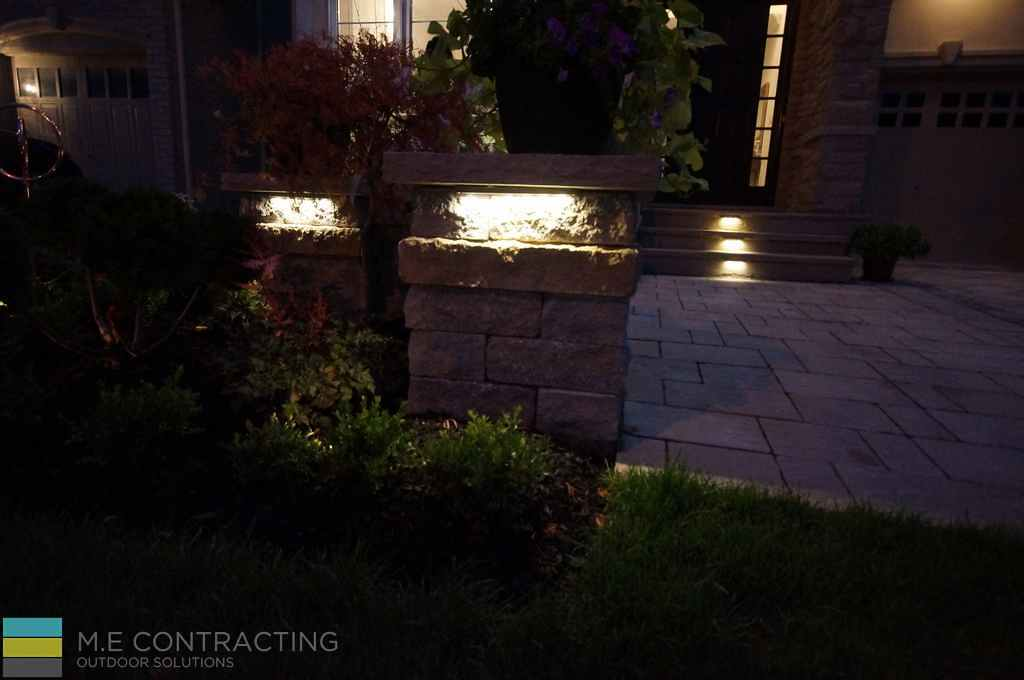 Interlocking, walkway and driveway, stone retaining wall, lighting, steps, landscaping