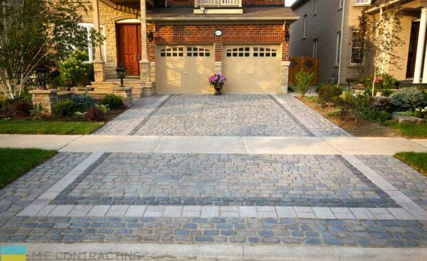 interlock driveway with softscape and flagstone front steps