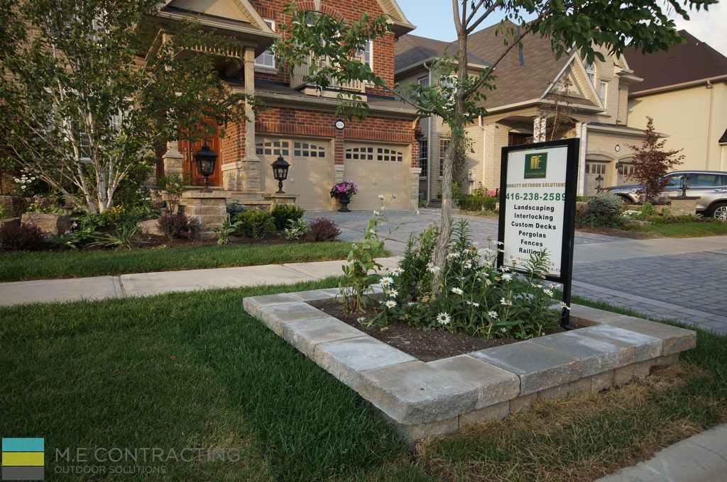 Landscaping, interlocking driveway, retaining wall, stone porch