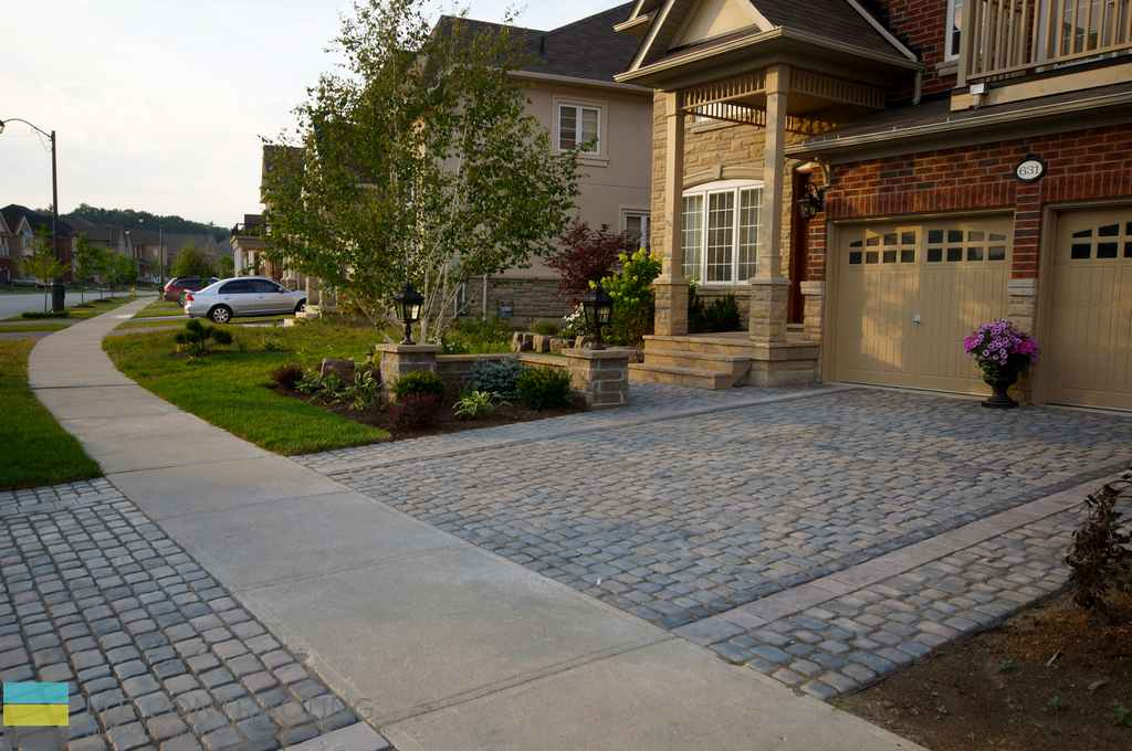 Interlock driveway with softscape and flagstone front for Driveway landscaping