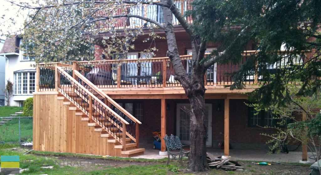 Cedar deck, aluminum railings with cedar frames, interlocking.