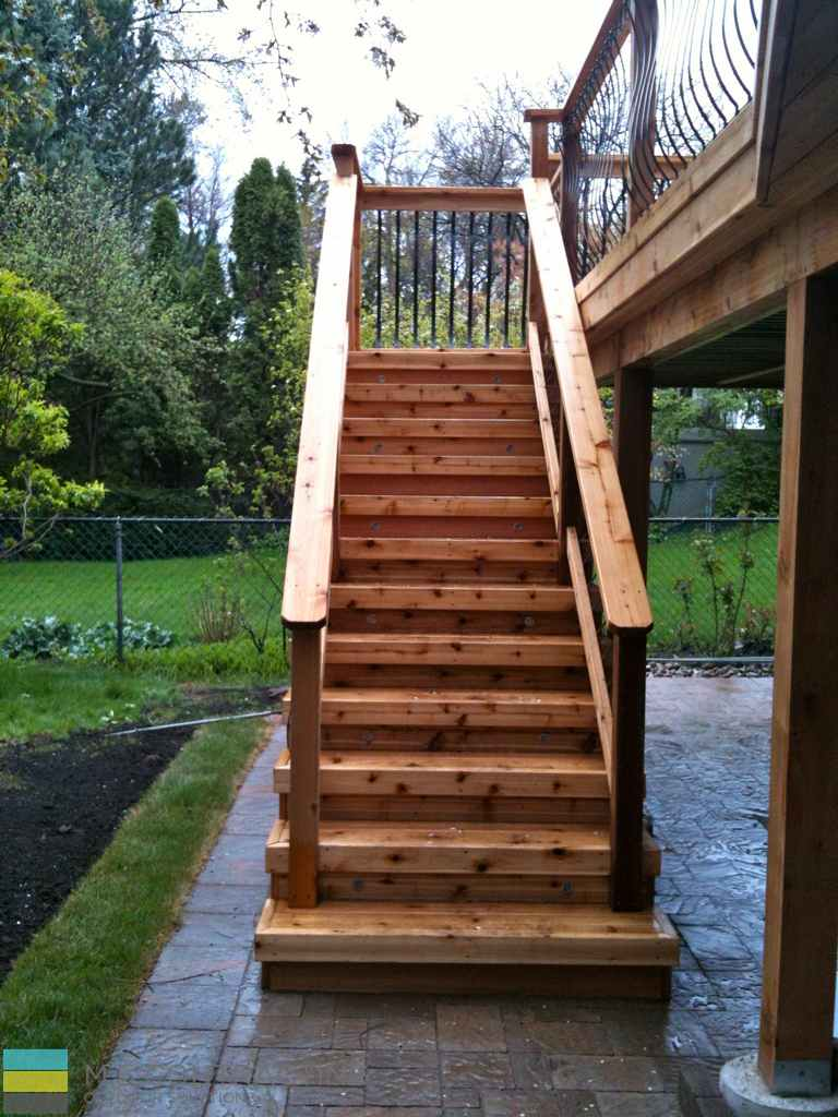 Interlocking, cedar deck and steps, landscaping, aluminum railings with cedar frames and posts