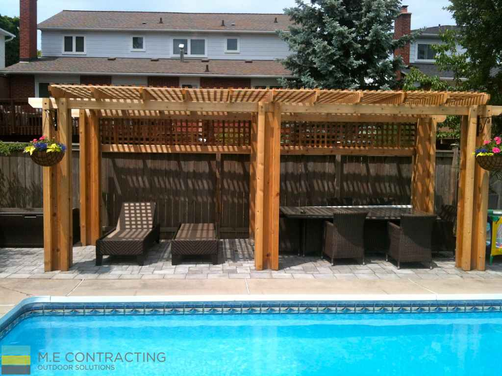 Fiberglass pool, interlocking, cedar pergola, outdoor patio