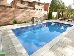 Fiberglass pool, interlocking stone walkway, landscaping, cedar fence and pergola, coping stone