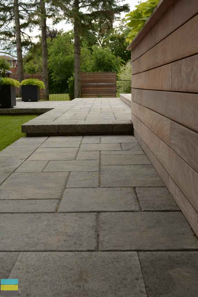 Interlocking walkway, cedar retaining wall, landscaping, cedar privacy fence