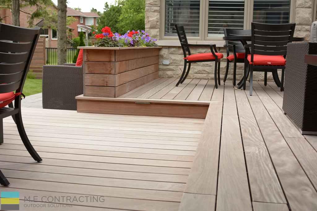 Cedar deck, retaining wall, landscaping, outdoor furniture