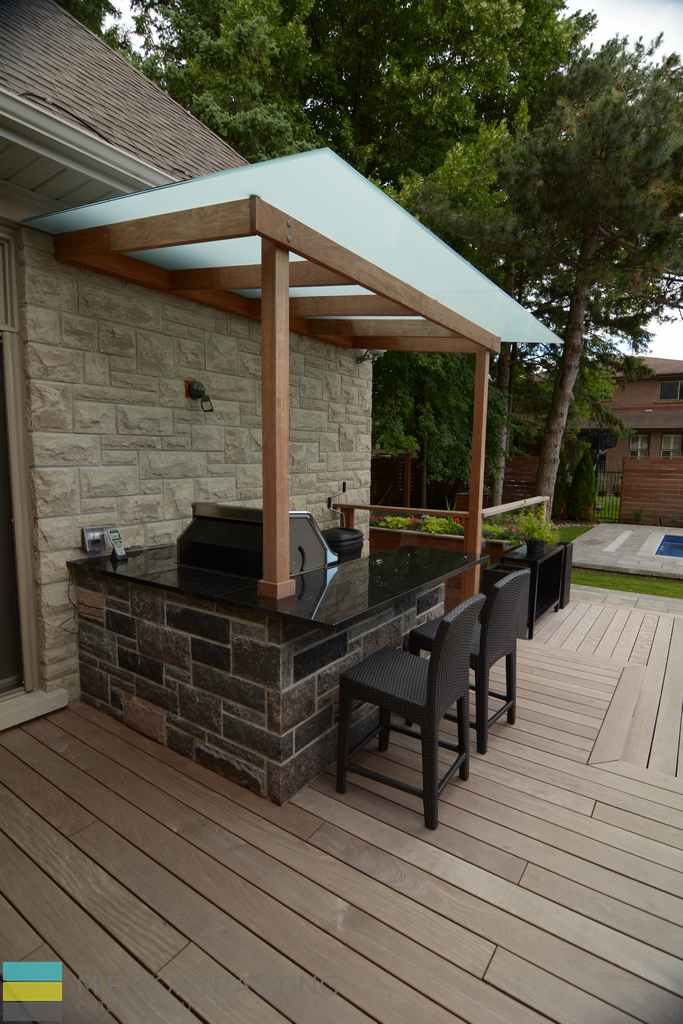 Stone Veneer, cedar deck, outdoor kitchen, pergola, interlocking patio