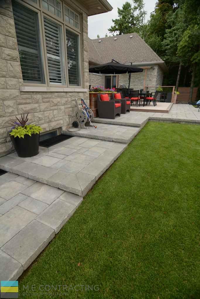 Stone Veneer, cedar deck, outdoor kitchen, pergola, interlocking patio