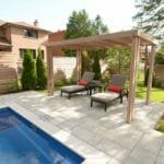 Fiberglass pool, interlocking stone walkway, landscaping, cedar fence and pergola, coping stone