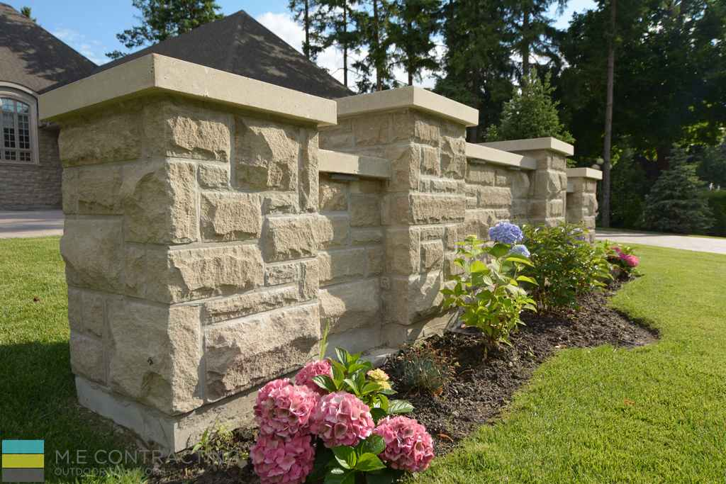 Stone wall, landscaping, flower bed, coping flagstone