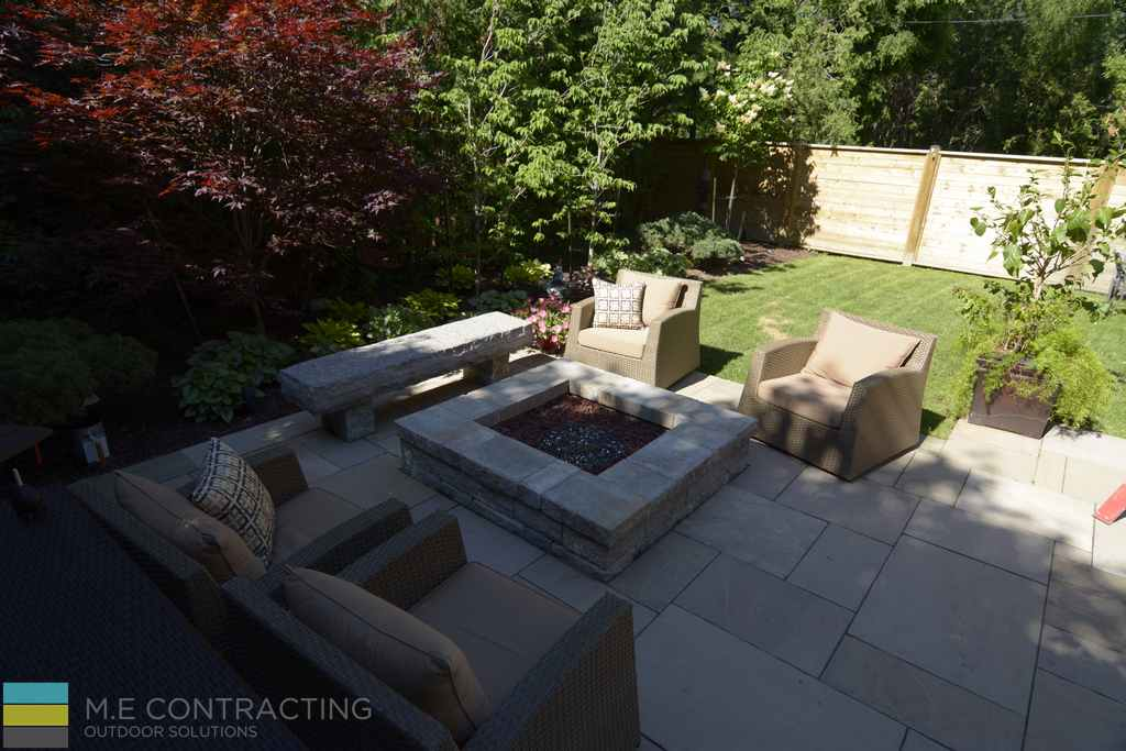 Interlocking stone, stone fire pit, armor stone, outdoor furniture, cedar fence, landscaping