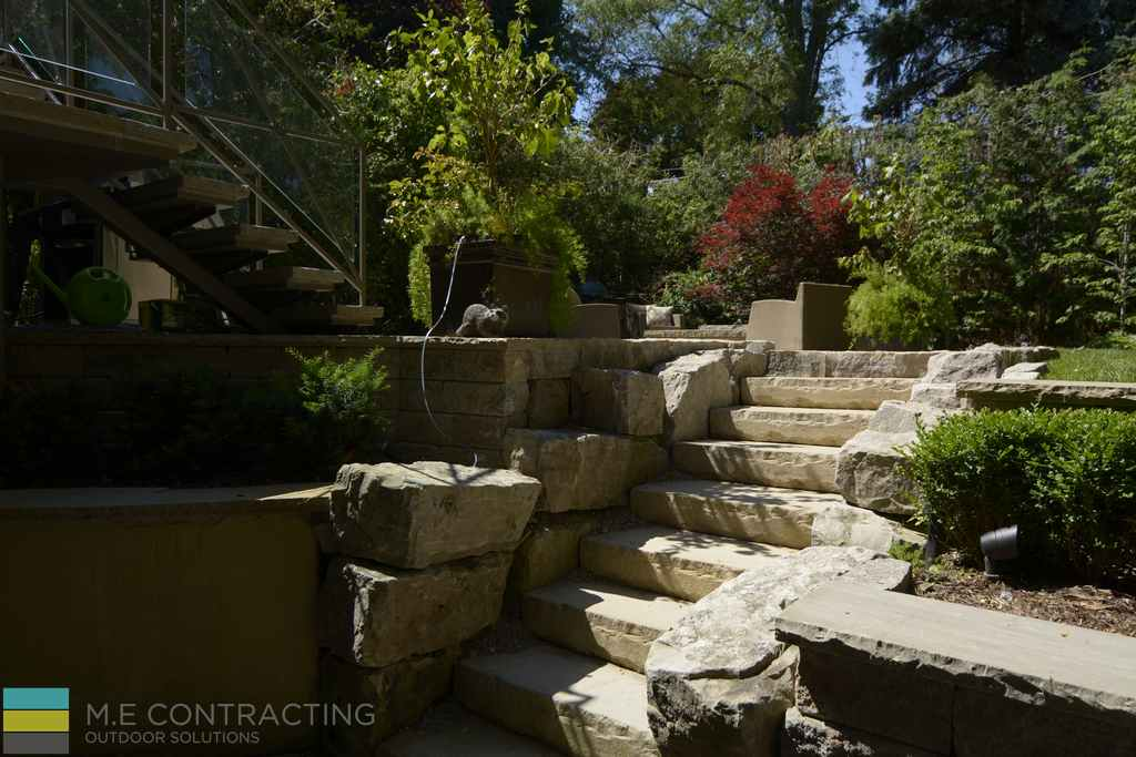Stone steps, landscaping, armor stone, tempered glass railings, wrought iron, stone fire pit,retaining wall