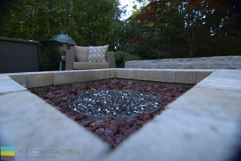 Stone fire pit, interlocking, outdoor furniture, cedar fence, armor stone bench