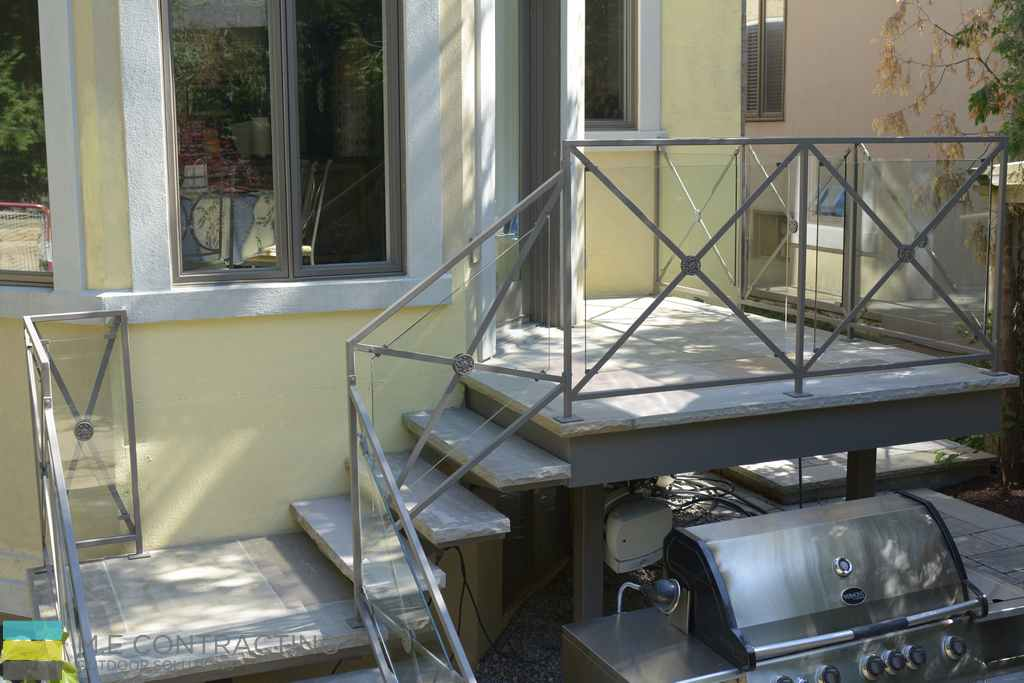 Interlocking stone, stone steps, tempered glass railings, wrought iron frames,stone ppebbles
