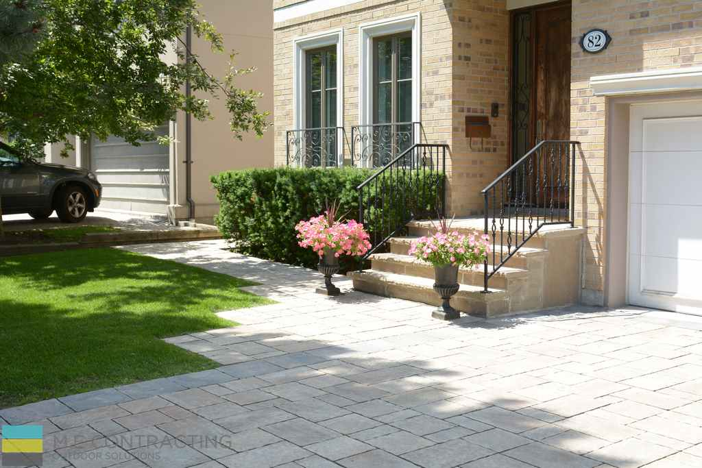 Interlocking driveway, landscaping, stone steps, wrought iron railings, front porch