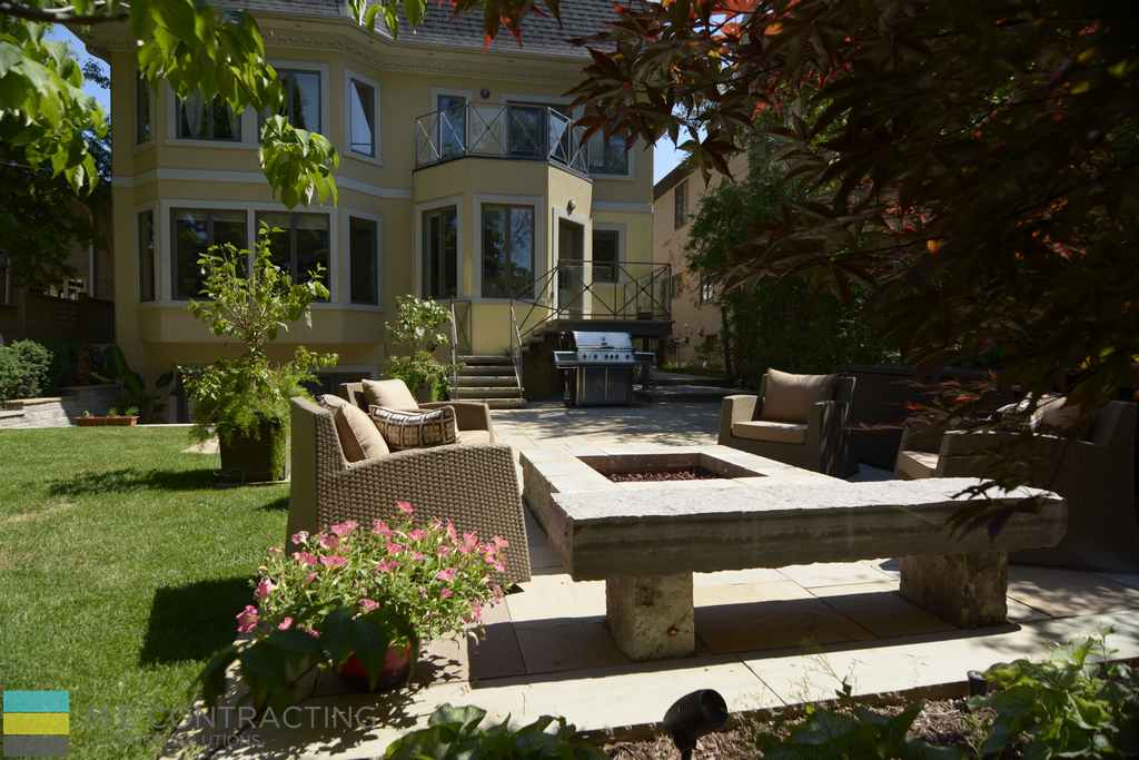 Interlocking, fire pit, outdoor furniture, landscaping, stone deck with tempered glass railings and wrought iron frames