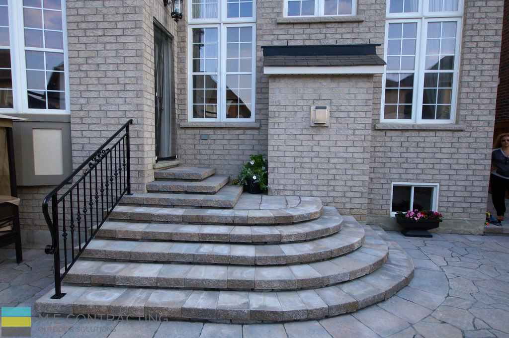 Interlocking, stone steps, wrought iron railing,