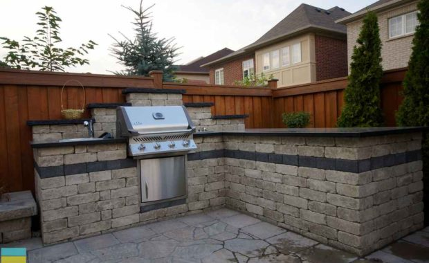 Landscaping, interlocking driveway, stairway and outdoor kitchen
