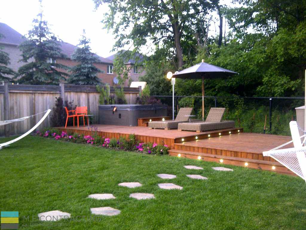 Landscaping project with 2 decks and interlocking area for Backyard patio landscaping